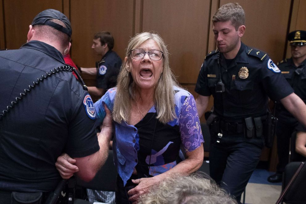 A woman is removed from the hearing by police as she shouts in protest against judge Brett Kavanaugh during the Senate Judiciary Committee's confirmation hearing on Kavanaugh's nomination to be an Associate Justice of the Supreme Court of the United States in Washington, Sept. 5, 2018.