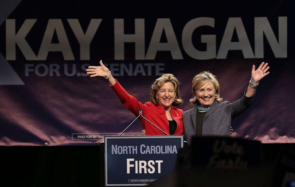 PHOTO: Former U.S. Secretary of State Hillary Clinton, right, campaigns for Sen. Kay Hagan, left, D-N.C., during a rally in Charlotte, N.C., Oct. 25, 2014.