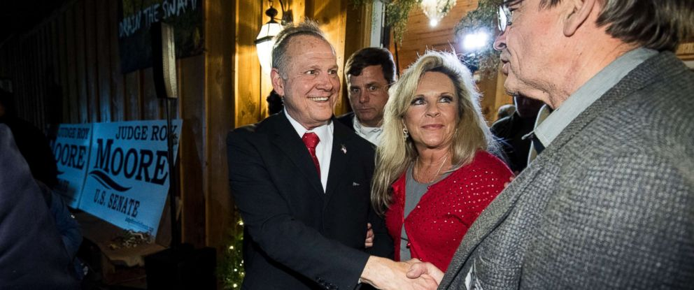 """PHOTO: Republican Senate candidate Roy Moore and his wife Kayla leave Moores """"Drain the Swamp"""" rally in Midland City, Ala., Dec. 11, 2017."""