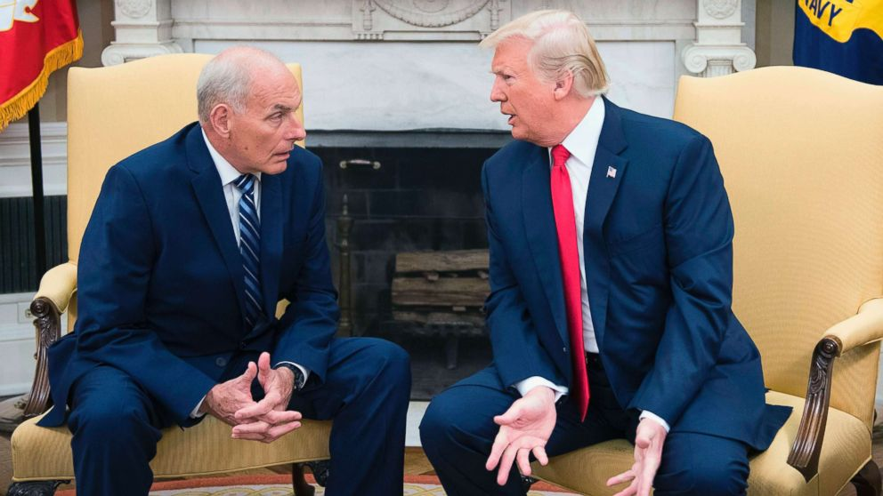 In this file photo, President Donald Trump (R) speaks with newly sworn-in White House Chief of Staff John Kelly at the White House in Washington, DC, July 31, 2017.