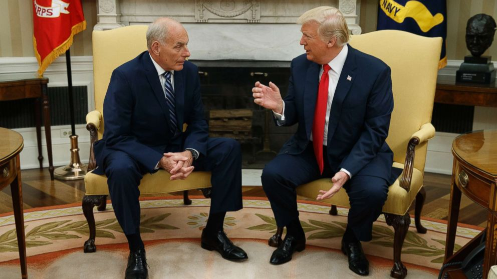 President Donald Trump talks with new White House Chief of Staff John Kelly after he was privately sworn in during a ceremony in the Oval Office with President Donald Trump, July 31, 2017, in Washington.