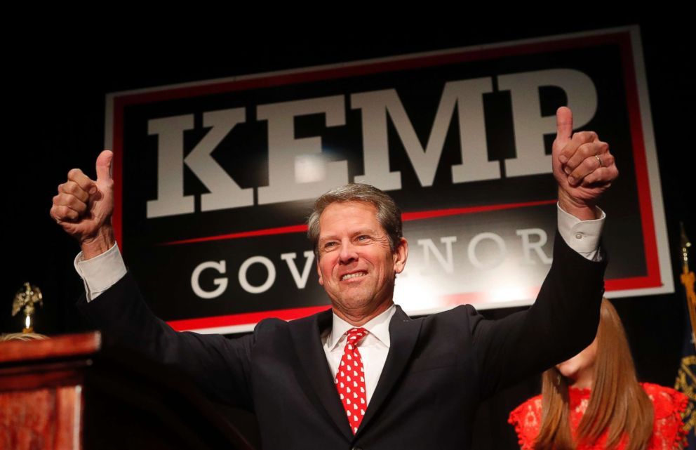 Georgia Republican gubernatorial candidate Brian Kemp gives a thumbs-up to supporters, in Athens, Ga., Nov. 7, 2018.