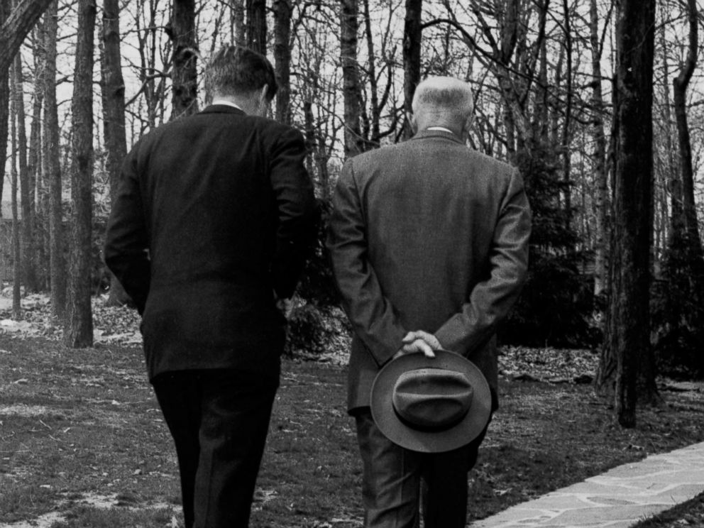 PHOTO: President John F. Kennedy and former President Dwight D. Eisenhower walk along a path at Camp David in Maryland on April 22, 1961, as the two met to discuss the failed Bay of Pigs invasion.