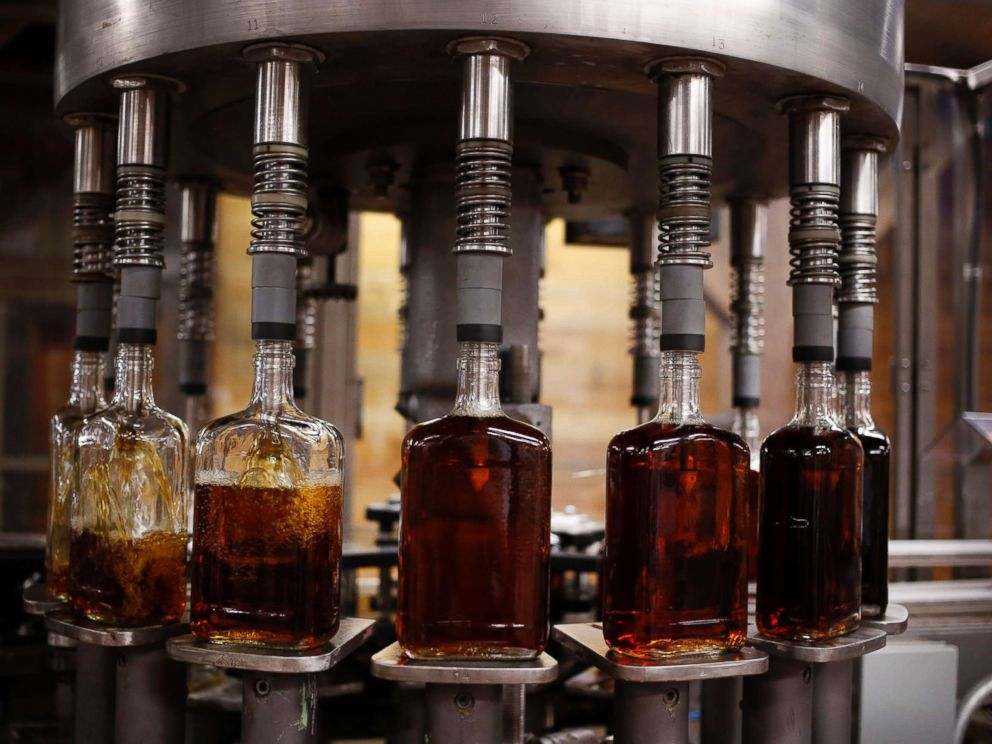 PHOTO: Bottles of Knob Creek single barrel bourbon are filled on the bottling line at the Beam Inc. distillery in Clermont, Ky., Aug. 1, 2013.