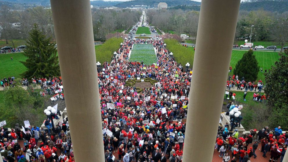 Teachers from across Kentucky gather outside the state Capitol to rally for increased funding and to protest changes to their state funded pension system, April 2, 2018, in Frankfort, Ky.