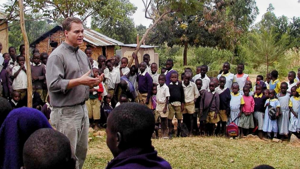 Professor Barrett speaking with a group of schoolchildren in Kenya.
