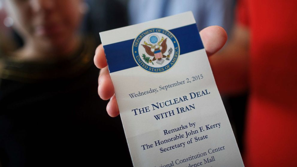 An attendee holds a ticket from the speech U.S. Secretary of State John Kerry delivered on the nuclear agreement with Iran at the National Constitution Center, Sept. 2, 2015, in Philadelphia.