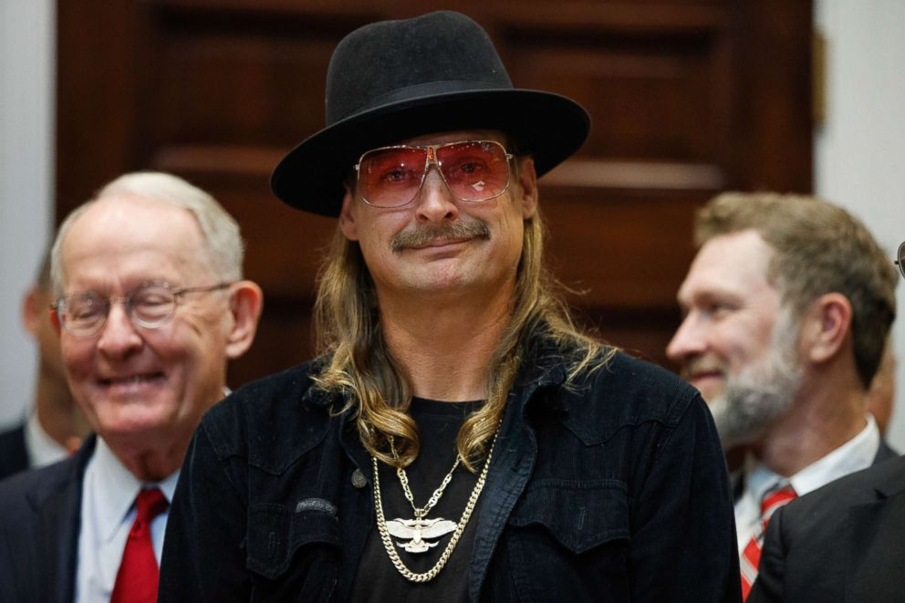 PHOTO: Musician Kid Rock listens as President Donald Trump speaks during a signing ceremony for the Orrin G. Hatch-Bob Goodlatte Music Modernization Act, in the Roosevelt Room of the White House, Oct. 11, 2018.