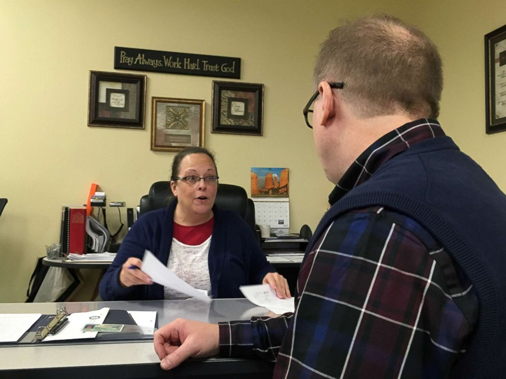 PHOTO: David Ermold speaks with Clerk Kim Davis as he files to run for Rowan County Clerk Wednesday, Dec. 6, 2017, in Morehead, Ky.