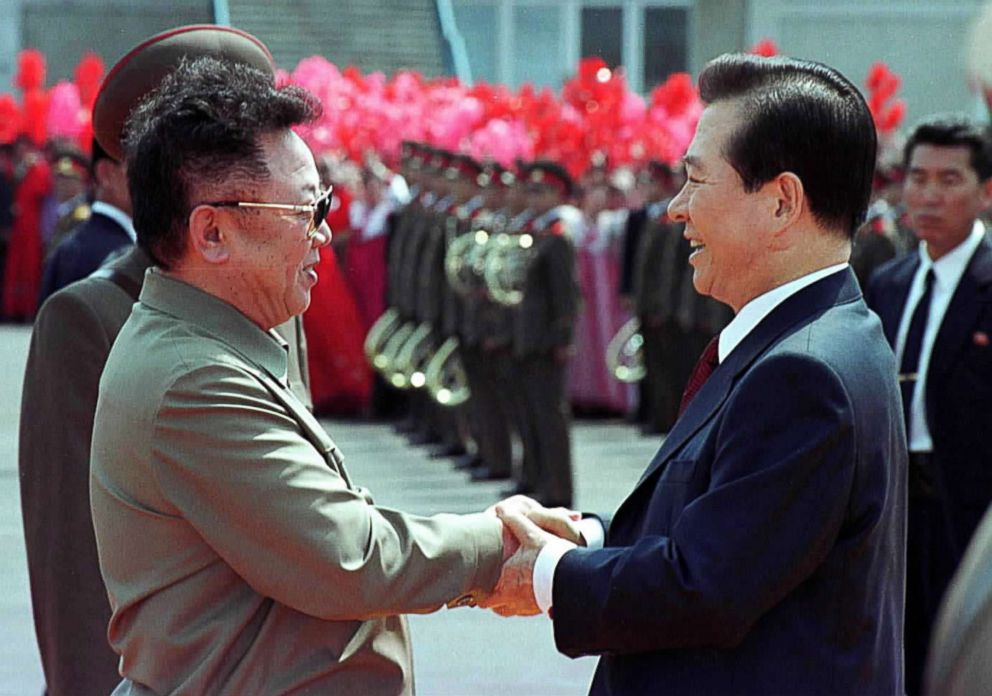 PHOTO: North Korean leader Kim Jong Il, left, and South Korean President Kim Dae-jung, right, shake hands as Kim Dae-jung arrives June 13, 2000 at the Sunan International Airport in Pyongyang, North Korea.