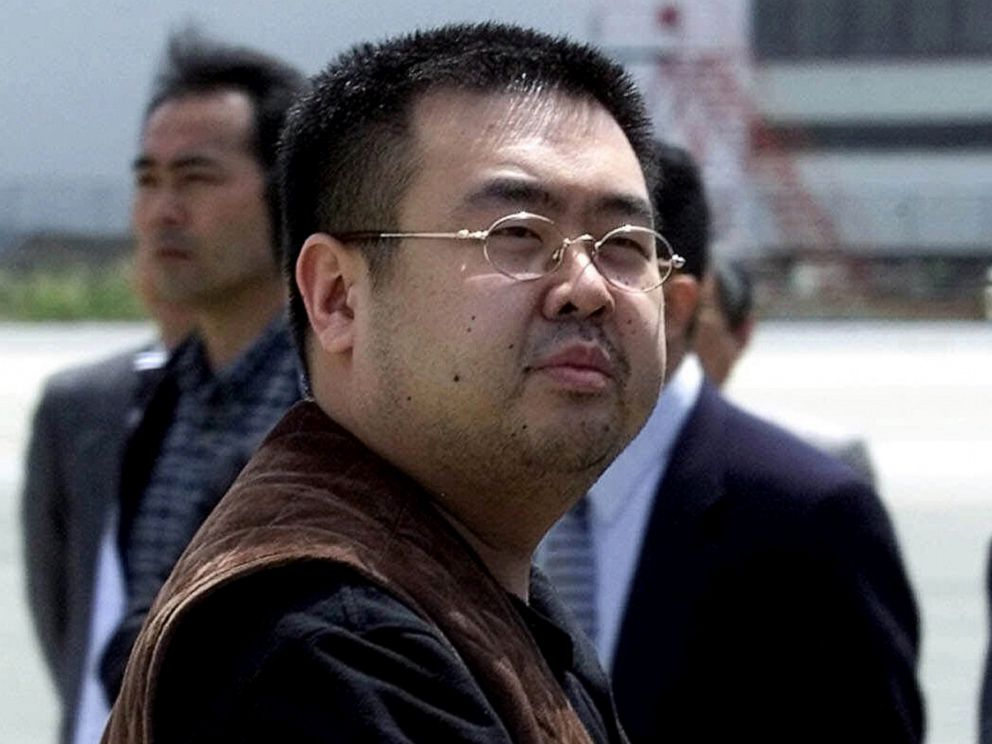 PHOTO: A man believed to be Kim Jong Nam, the eldest son of then North Korean leader Kim Jong Il, looks at a battery of photographers as he exits a police van to board a plane to Beijing at Narita international airport in Narita, Japan, May 4, 2001.