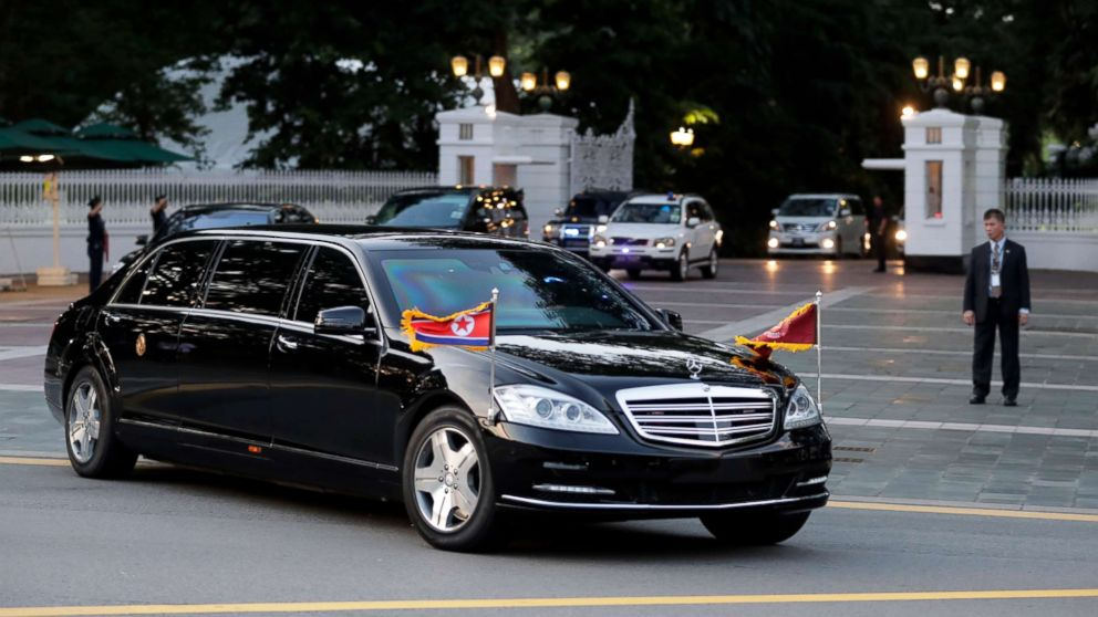 The car with flags flying carrying North Korean leader Kim Jong-un leaves Istana Presidential Palace after a meeting with Singapore Prime Minister Lee Hsien Loong in Singapore, June 10, 2018.