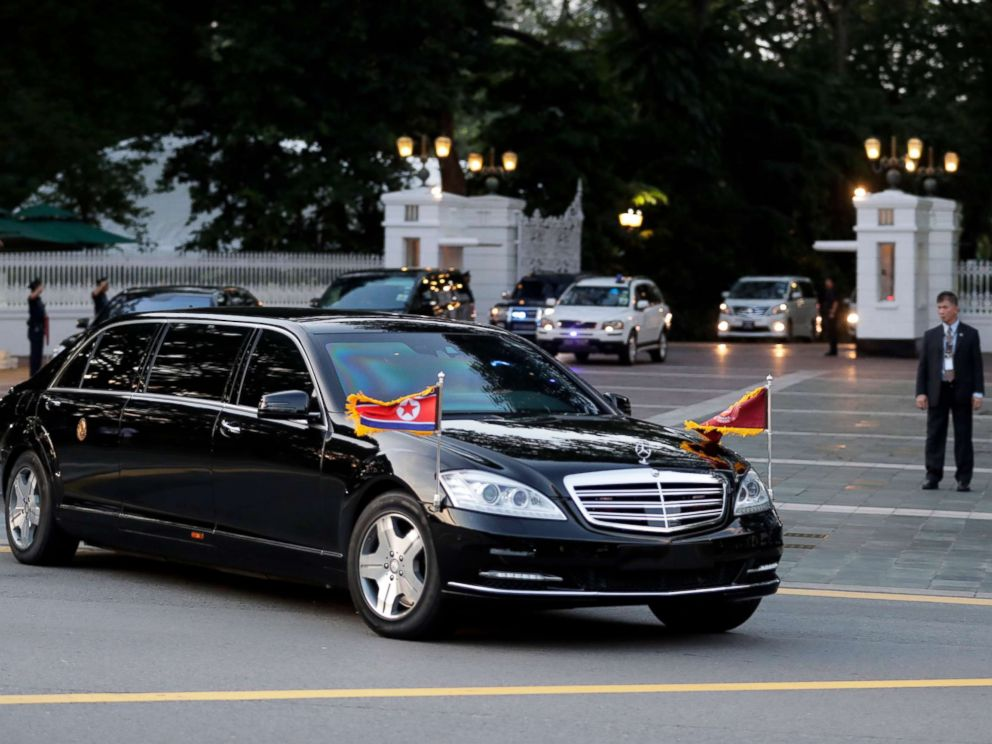 PHOTO: The car with flags flying carrying North Korean leader Kim Jong-un leaves Istana Presidential Palace after a meeting with Singapore Prime Minister Lee Hsien Loong in Singapore, June 10, 2018.