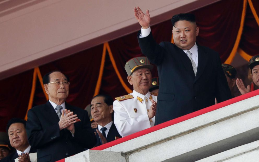 PHOTO: North Korean leader Kim Jong Un waves while officials, from left, Choe Ryong Hae, Kim Yong Nam, Pak Pong Ju, and Hwang Pyong So applaud during a military parade in Pyongyang, April 15, 2017.