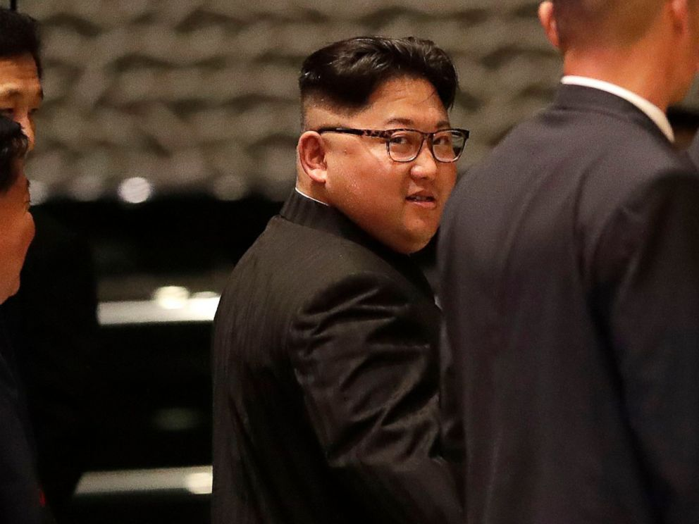 PHOTO: North Korean leader Kim Jong Un walks out from the Marina Bay Sands hotel during a city tour in Singapore, June 11, 2018.