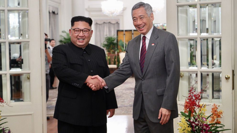 North Korean leader Kim Jong-un (L) and Singapore Prime Minister Lee Hsien Loong (R) shake hands during their meeting at the Istana Presidential Palace in Singapore, June 10, 2018.