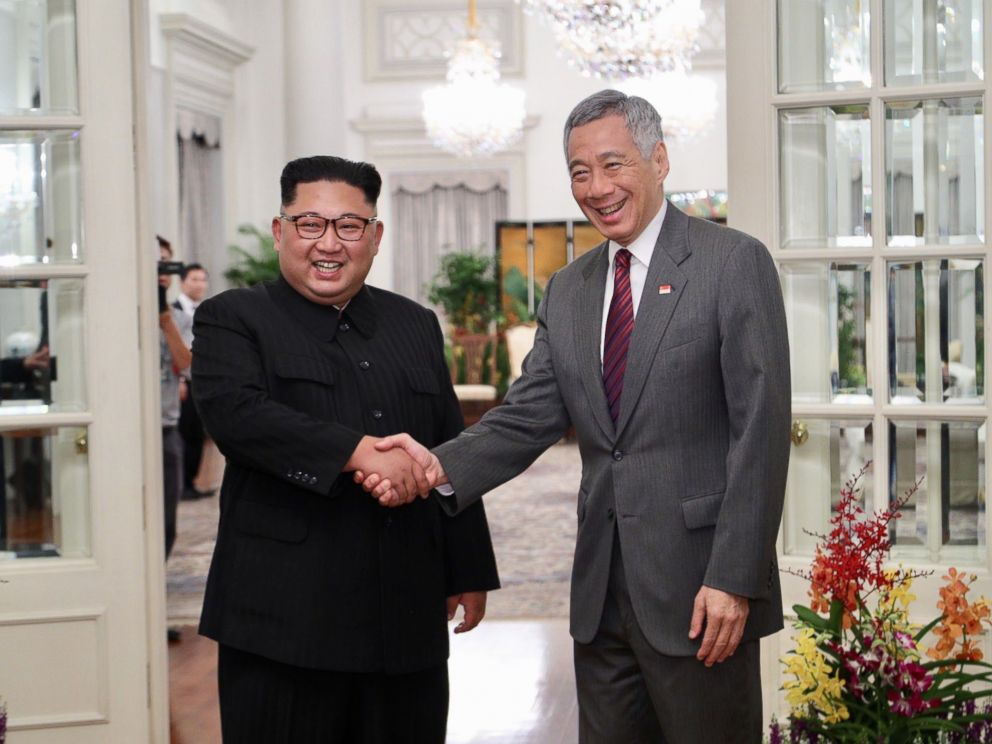 PHOTO: North Korean leader Kim Jong-un (L) and Singapore Prime Minister Lee Hsien Loong (R) shake hands during their meeting at the Istana Presidential Palace in Singapore, June 10, 2018.