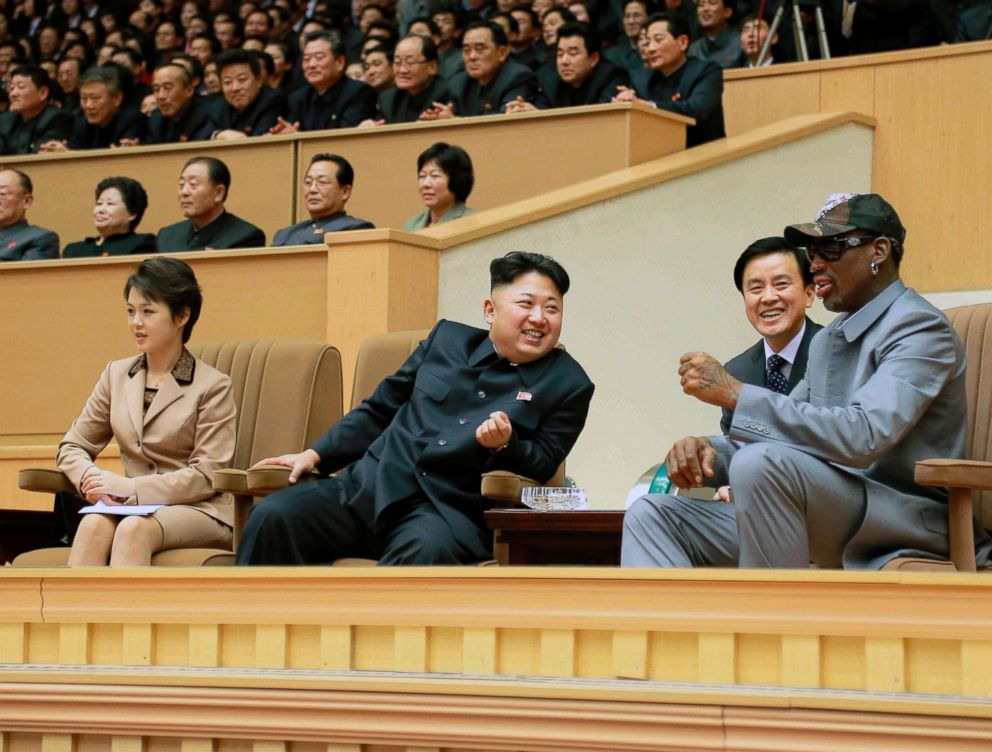 North Korean leader Kim Jong Un watches a basketball game between former NBA basketball players and North Korean players of the Hwaebul team of the DPRK with Dennis Rodman, right, at Pyongyang Indoor Stadium in this undated photo in Pyongyang.