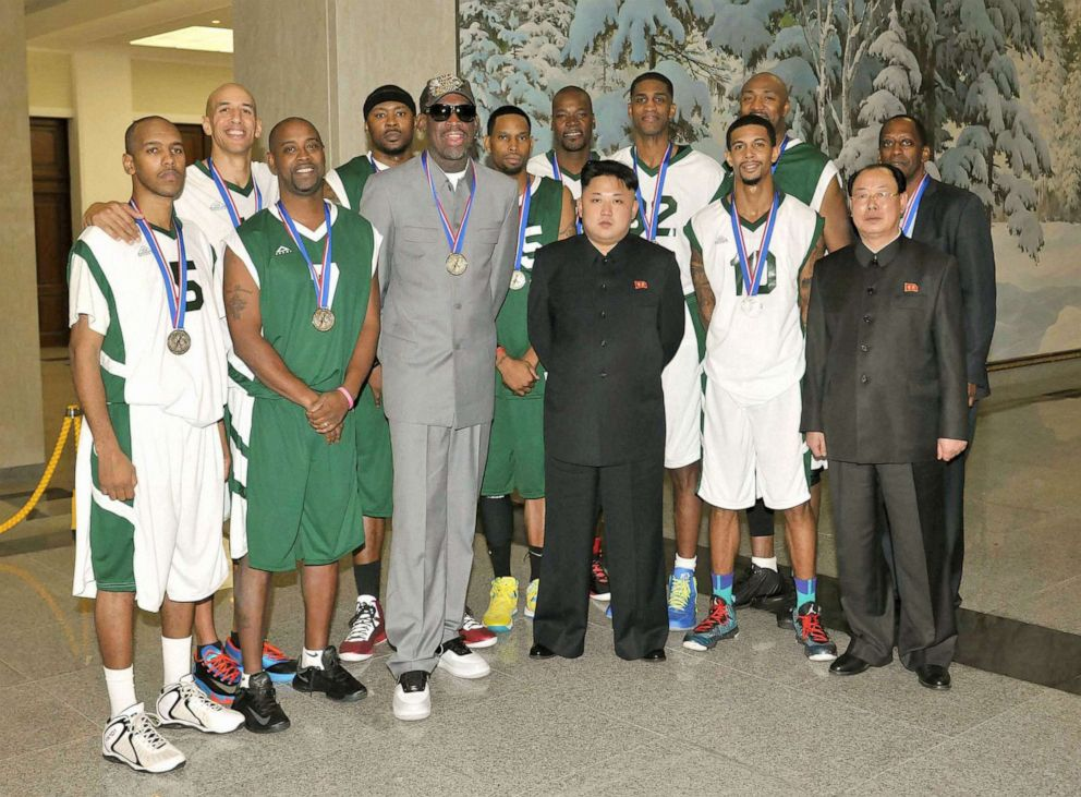 PHOTO: Former U.S. basketball star Dennis Rodman (3rd from L, front row) and other American basketball players pose for photos with North Korean leader Kim Jong Un (3rd from R, front row) at the Pyongyang Indoor Stadium, Jan. 8, 2014.