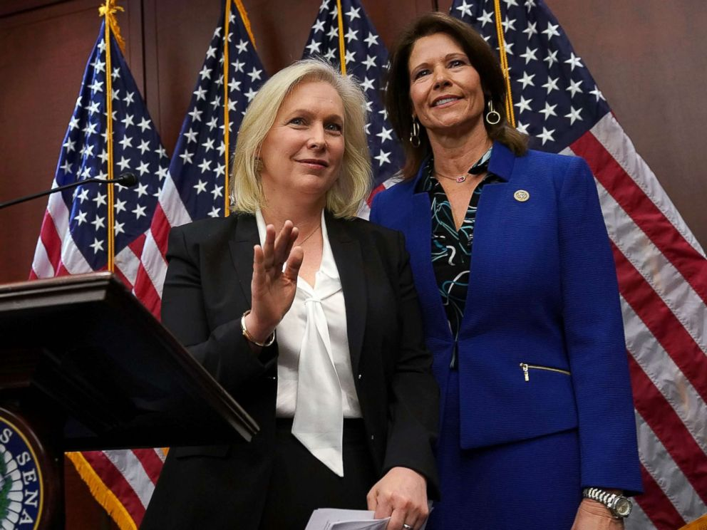 PHOTO: Sen. Kirsten Gillibrand, left, speaks, as Rep. Cheri Bustos listens, during a news conference, Dec. 6, 2017, on Capitol Hill in Washington.