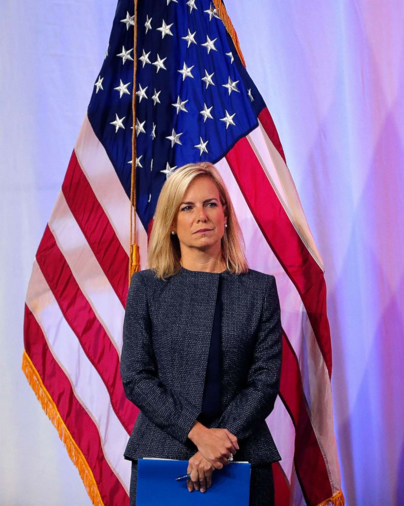 Secretary of Homeland Security Kirstjen Nielsen stands onstage as she is introduced to speak at the National Sheriffs' Association convention in New Orleans, June 18, 2018.