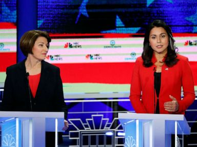PHOTO: Amy Klobuchar and Tulsi Gabbard participate in the first Democratic primary debate hosted by NBC News at the Adrienne Arsht Center for the Performing Arts in Miami, Florida, June 26, 2019.