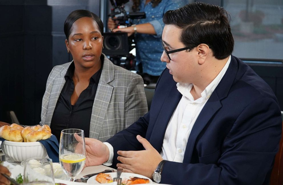 PHOTO: Massachusetts voters Lianne Hughes-Odom and Neil Sharma participate in a conversation with 2020 Democratic presidential candidate Amy Klobuchar at a restaurant in Bedford, N.H., along with ABC News Byron Pitts.