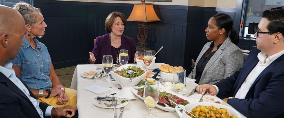 PHOTO: ABC News' Byron Pitts moderates a conversation with 2020 Democratic presidential candidate Amy Klobuchar on the campaign trail and three undecided voters at a restaurant in Bedford, N.H.