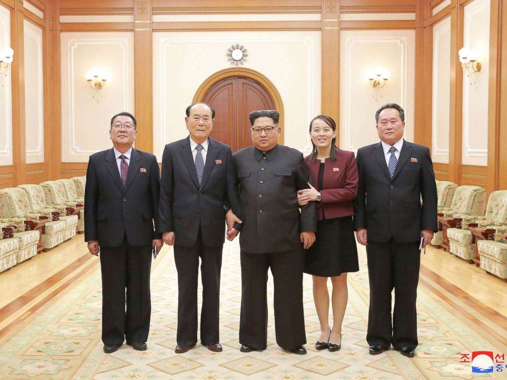 PHOTO: In a handout photograph released by the North Korean News Agency, North Koreas Kim Jong-un, center is shown with members of the high-level delegation, including his sister, Kim Yo-jong, who visited South Korea to attend the 2018 Winter Olympics.