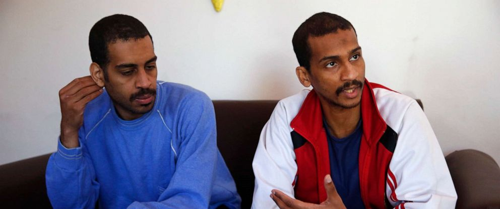PHOTO: Alexanda Amon Kotey, left, and El Shafee Elsheikh speak during an interview with The Associated Press at a security center in Kobani, Syria, March 30, 2018.