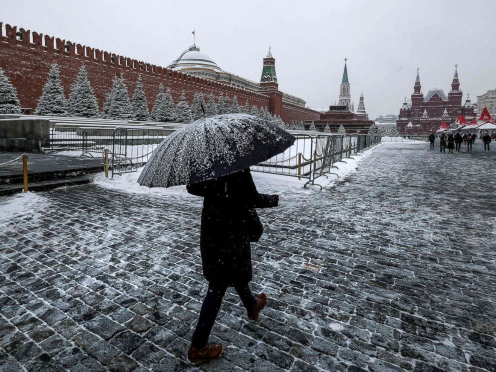 PHOTO: A woman with an umbrella walks on Red Square past the Kremlin after a night of heavy snowfall in Moscow on Dec. 6, 2018.