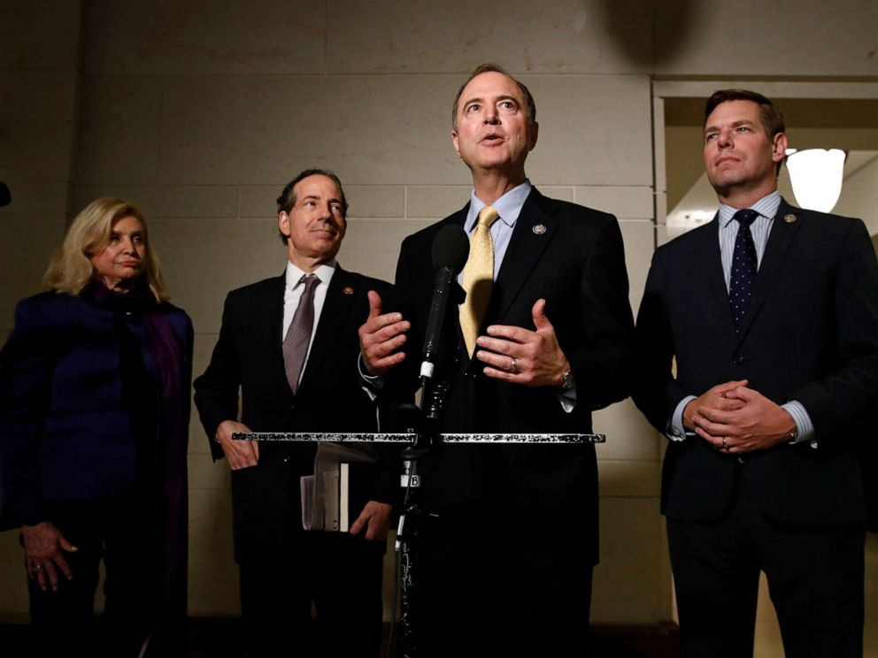 PHOTO: Rep. Adam Schiff, D-Calif., second from right, speaks with members of the media after former deputy national security adviser Charles Kupperman signaled that he would not appear as scheduled for a closed door meeting.