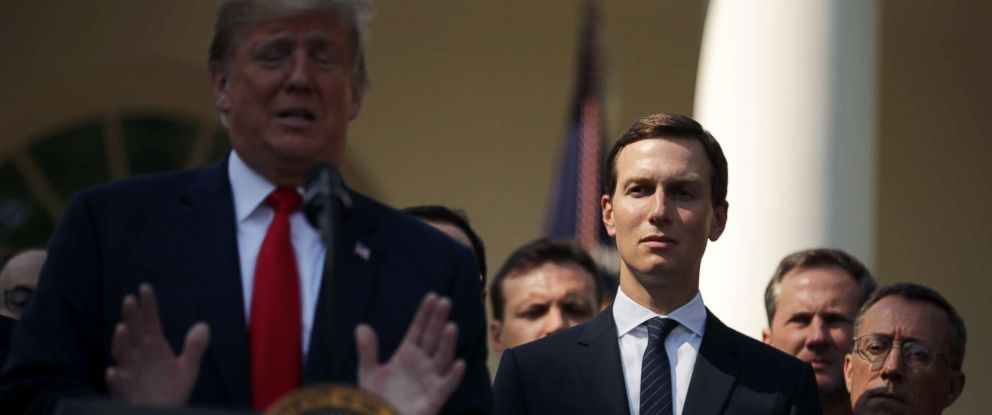 PHOTO: White House senior adviser Jared Kushner, center, listens as President Donald Trump speaks during a press conference in the Rose Garden of the White House, Oct. 1, 2018.
