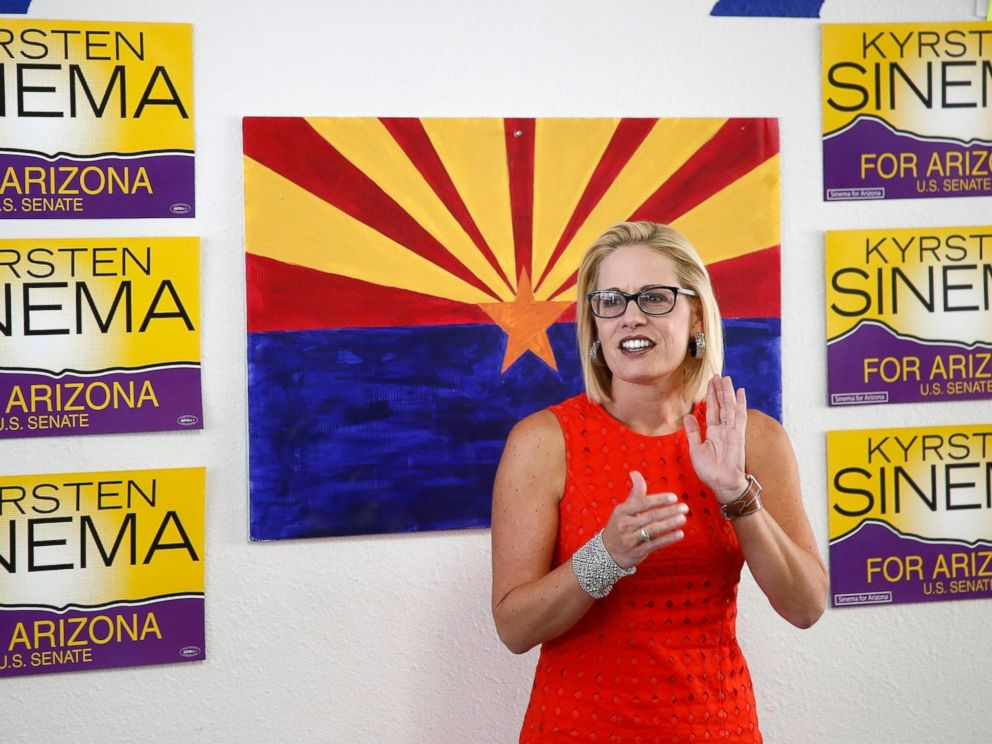 PHOTO: In this Aug. 28, 2018, file photo, Rep. Kyrsten Sinema, D-Ariz., talks to campaign volunteers at a Democratic campaign office in Phoenix.