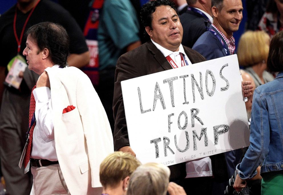 PHOTO:A delegate holds a sign that reads Latinos For Trump before the start of the third day of the Republican National Convention on July 20, 2016, in Cleveland.