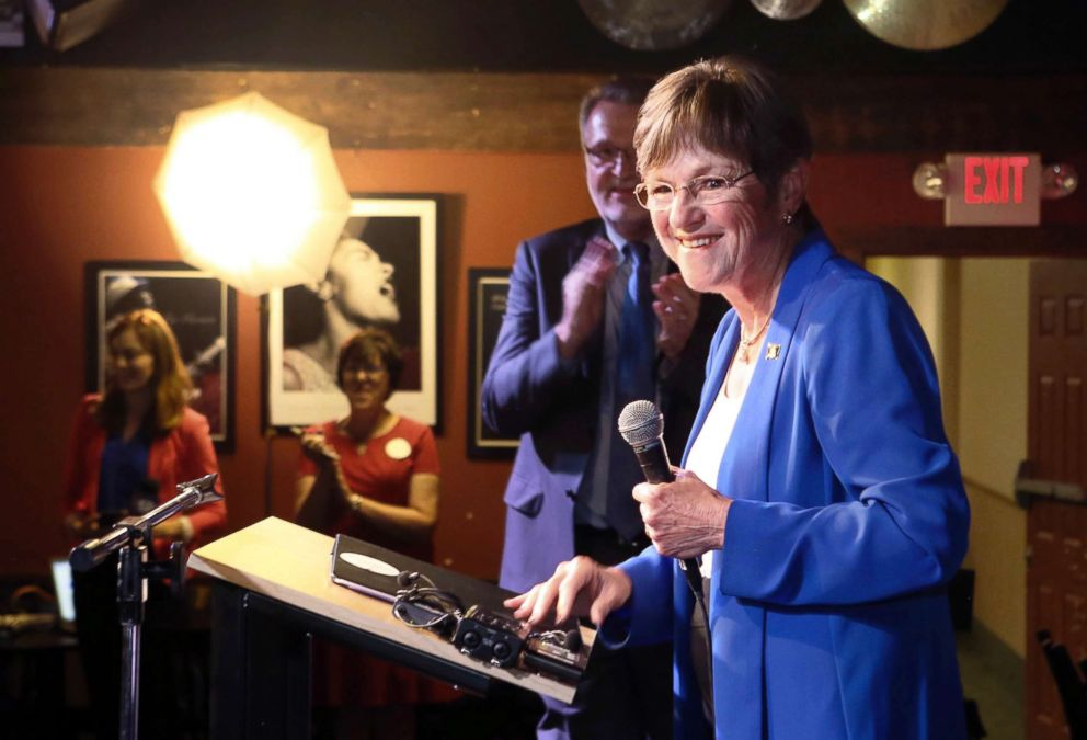 PHOTO: State Sen. Laura Kelly, with her running mate Lynn Rogers behind her, speaks after it was announced that she was the winner in the Democratic race for governor at the Ramada Hotel and Convention Center in Topeka, Kansas,Aug. 7, 2018.