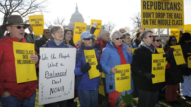 PHOTO: Families and small business owners gather outside the US Capitol to protest inaction by Congress to pass legislation to avoid the fiscal cliff, Dec. 28, 2012, in Washington, DC.