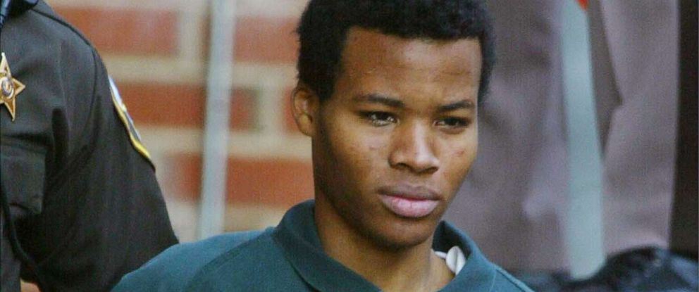 PHOTO: Accused sniper Lee Boyd Malvo walks out of the Fairfax County Juvenile Court House after appearing with his attorneys November,19, 2002, in Fairfax, Virginia.