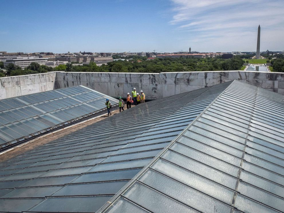 PHOTO: Reporters and officials walk between the skylights on the roof during a tour of on-going work on the rehabilitation of the Lincoln memorial, June, 14, 2018, in Washington, DC.