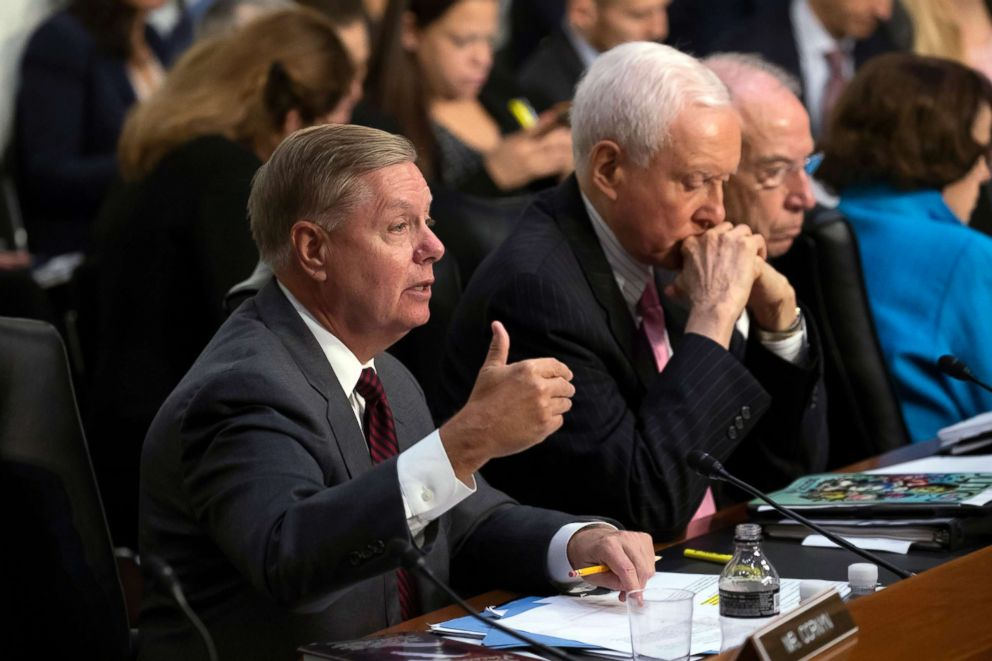 PHOTO: Sen. Lindsey Graham, joined by Sen. Orrin Hatch and Senate Judiciary Committee Chairman Chuck Grassley, questions Supreme Court nominee Brett Kavanaugh during the second day of his confirmation hearing, on Capitol Hill in Washington, Sept. 5, 2018.