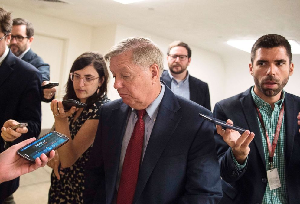 PHOTO: Senator Lindsey Graham is surrounded by reporters on July 17, 2018, on Capitol Hill in Washington, D.C.