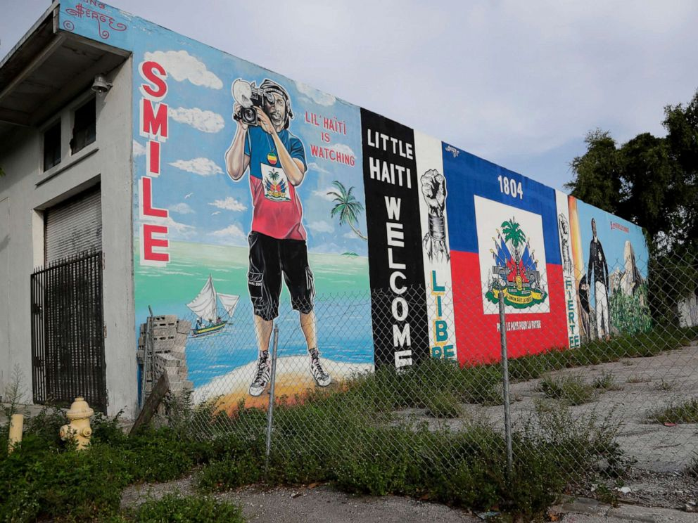 PHOTO: Murals adorn a wall next to a vacant lot in the Little Haiti neighborhood of Miami, July 16, 2019.