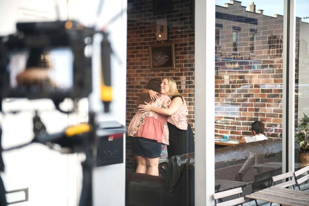PHOTO: Congressional candidate Liuba Grechen Shirley hugs a supporter while filming an campaign ad on July 24, 2018, at a local coffee shop.