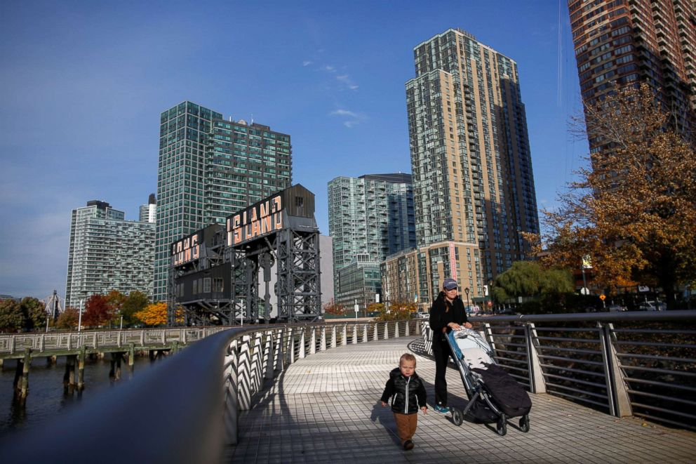 PHOTO: People walk along Gantry Plaza State Park, in Long Island City, New York, Nov. 7, 2018.
