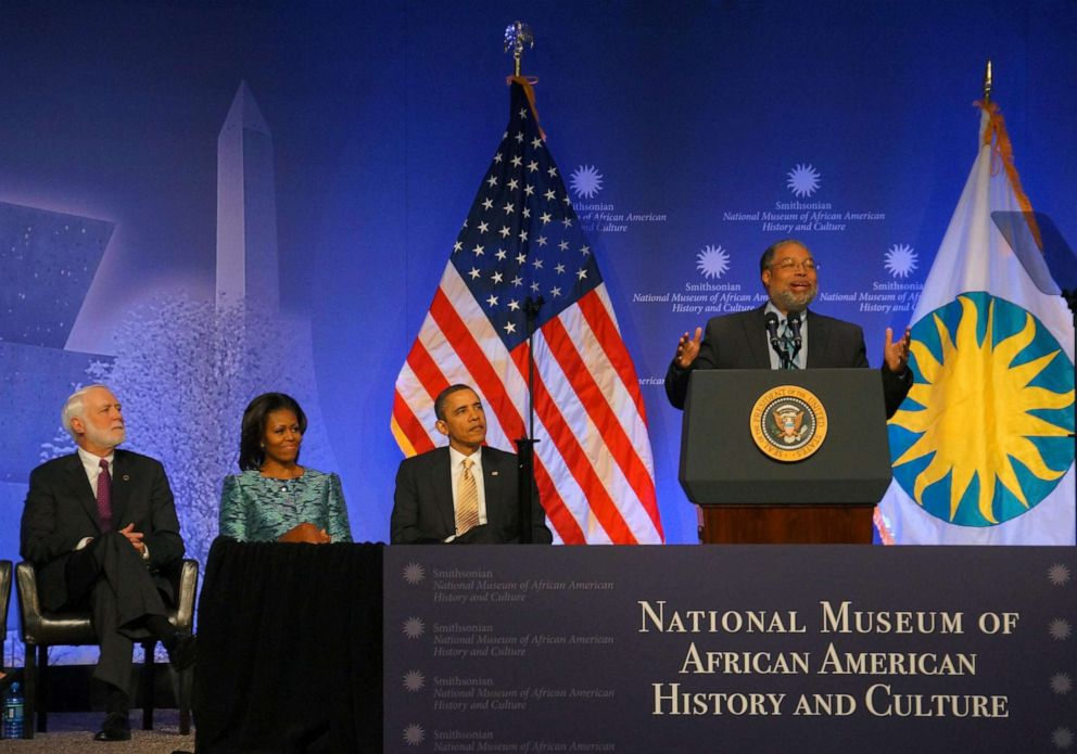 PHOTO: Lonnie Bunch speaks at the museums groundbreaking ceremony on the National Mall in Washington, D.C. on Feb. 22, 2012, flanked by Smithsonian Secretary G. Wayne Clough, First Lady Michelle Obama and President Barack Obama.