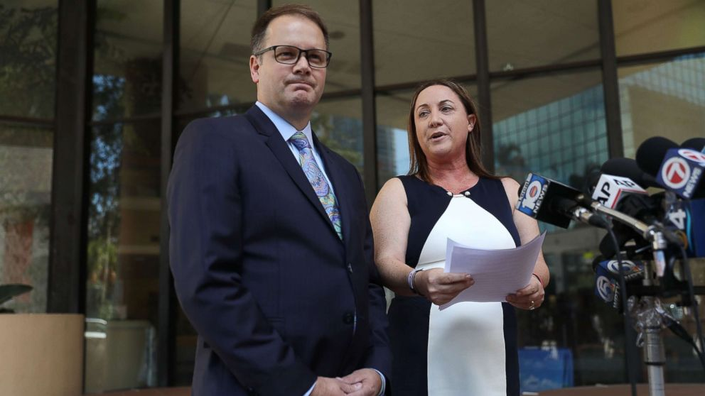 Ryan Petty and Lori Alhadeff speak to the media after turning in their paperwork to run for the Broward County School Board, May 15, 2018, in Fort Lauderdale, Fla. Ryan Petty's 14 year old daughter Alaina JoAnn Petty and Lori Alhadeff's 14 year old daughter Alyssa were killed during the mass shooting at Marjory Stoneman Douglas High School on February 14th.