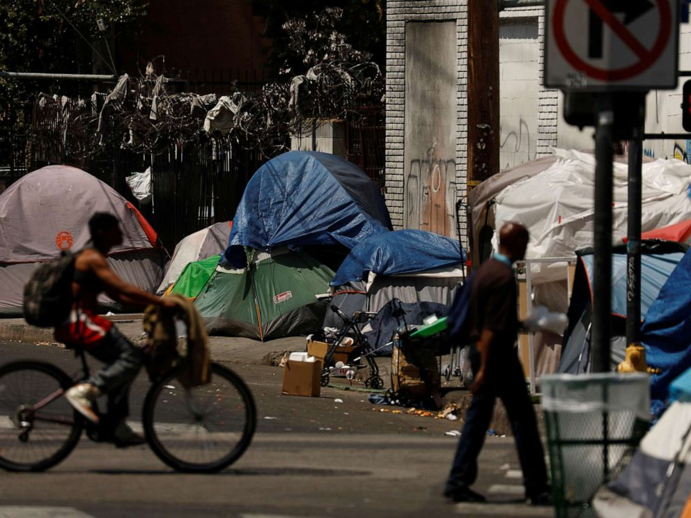 PHOTO: Tents and tarps erected by homeless people are shown along sidewalks and streets in the skid row area of downtown Los Angeles, June 28, 2019.