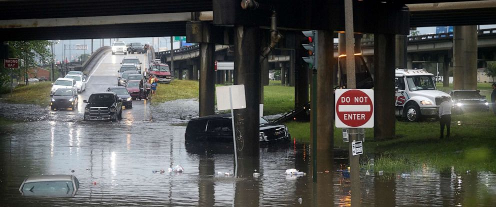 PHOTO: Motorists react in New Orleans react as the intersection at Franklin Ave. and 610 floods after a severe thunderstorm, July 10, 2019.