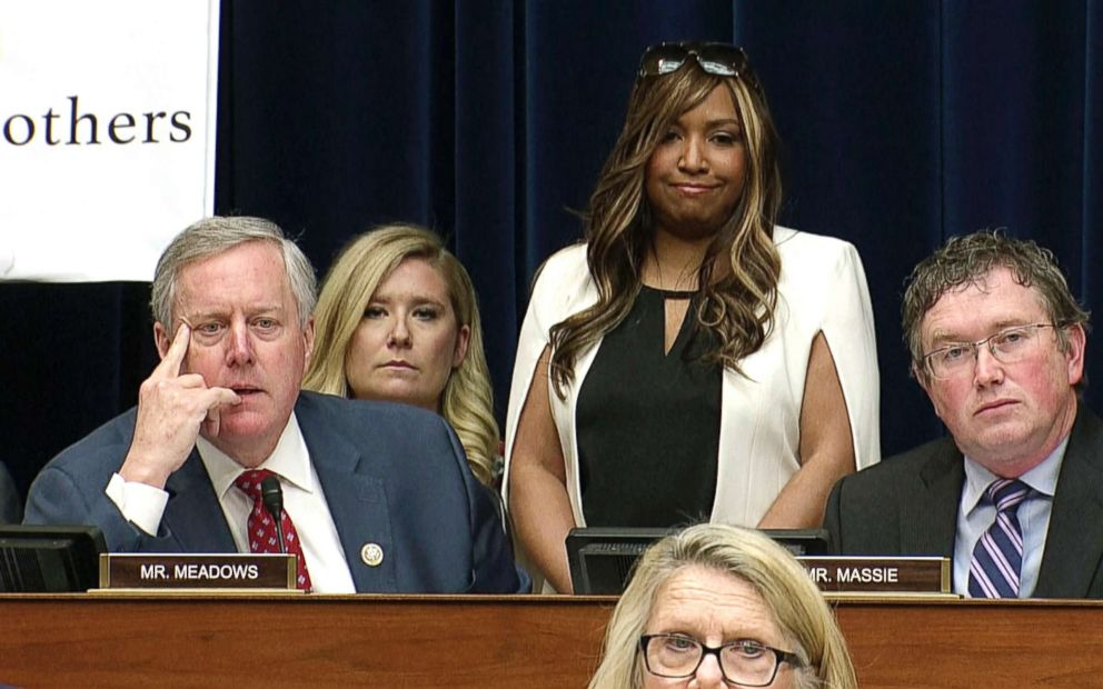 PHOTO: In this image made from a Feb. 27, 2019, video, Lynne Patton who works in the Trump administration at the Department of Housing and Urban Development, stands behind Rep. Mark Meadows as Michael Cohen testifies on Capitol Hill in Washington, D.C.