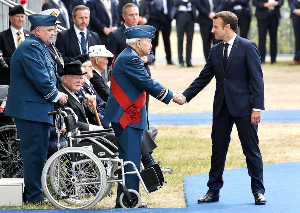 PHOTO:French President Emmanuel Macron shakes hands with a veteran as he returns to his seat during an event to commemorate the 75th anniversary of the D-Day landings, in Portsmouth, southern England, June 5, 2019.